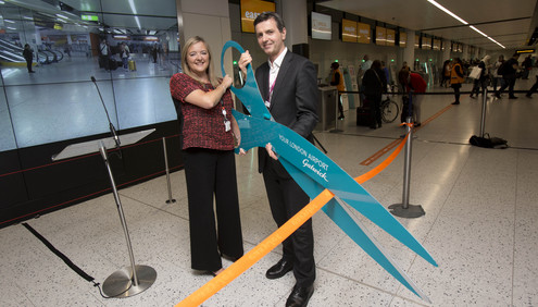 GATWICK AIRPORT'S GUY STEPHENSON AND EASYJET'S SOPHIE DEKKERS OPEN THE WORLD'S LARGEST SELF SERVICE BAG DROP TODAY.