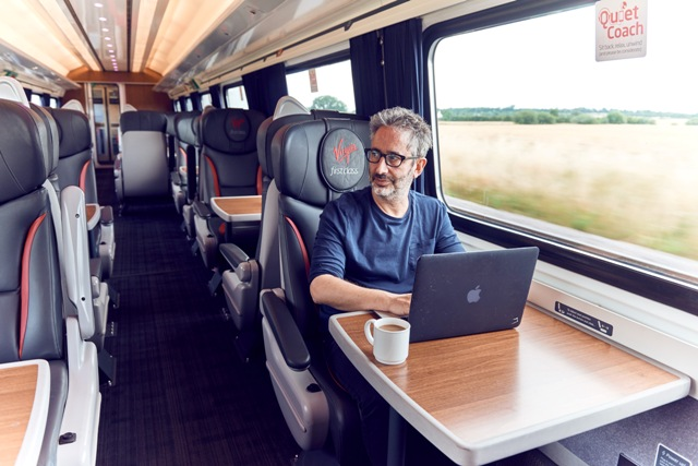 Tuesday 26th July 2016: Virgin Trains today unveiled David Baddiel as its new 'Summer Author'. The comedian and award-winning children's author will have a unique role writing a children's story inspired by some of the customers he meets as he journeys across the UK on Virgin Trains For further information please contact Lauren Beeslee at Hope & Glory PR at lauren.beeslee@hopeandglorypr.com or on 020 3588 9700 PR Handout - free for editorial usage Copyright: © Mikael Buck / Virgin Trains