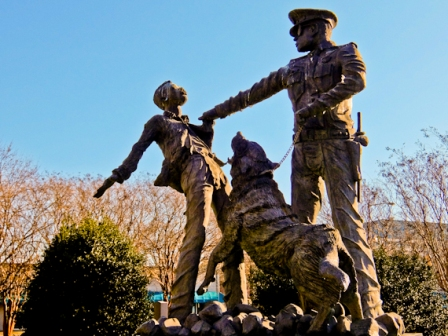 Police dog attacks child statue