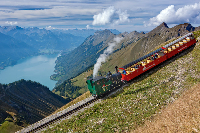 Switzerland. get natural. The Brienzer Rothorn steam-powered cogwheel train in the Bernese Oberland. View of Lake Brienz. Schweiz. ganz natuerlich. Die Brienzer Rothorn Dampfzahnradbahn im Berner Oberland. Blick auf den Brienzersee. Suisse. tout naturellement. Le train a cremaillere a vapeur du Rothorn de Brienz, dans l'Oberland bernois. Vue du lac de Brienz. Copyright by: Switzerland Tourism By-Line: swiss-image.ch / Christof Sonderegger